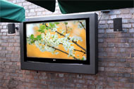 armagard outdoor tv enclosure mounted on a patio wall