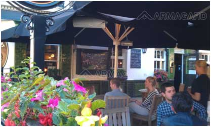 LCD enclosure installation - people sat in a beer garden watching tv housed in an armagard enclosure